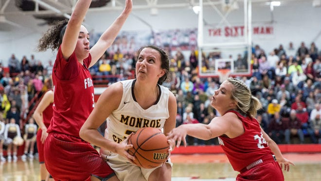 Monroe Central's Abigail McGrath drives in to score during the Frankton girls basketball sectional championship on Feb. 3 at Frankton High School. The game was Monroe Central's first loss of the season with a final score of 66-61.