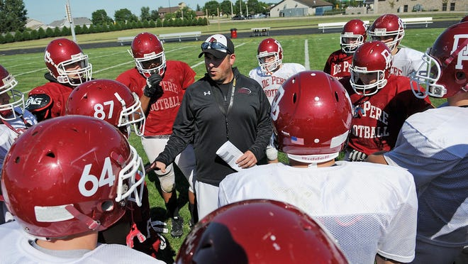 De Pere football coach Chad Michalkiewicz is seeking his first opening-night win.