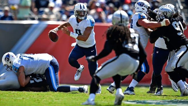 Titans quarterback Marcus Mariota (8) scrambles in the third quarter Sunday, Sept. 10, 2017, at Nissan Stadium.