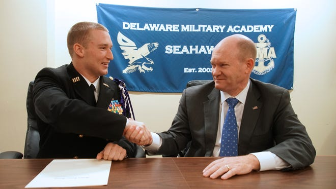 Jacob W. Hudson, a senior at the Delaware Military Academy, shakes hands with Sen. Chris Coons after being told he has been nominated for the U.S. Naval Academy in Annapolis.
