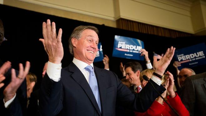 Georgia Republican David Perdue celebrates his election to the Senate Tuesday, Nov. 4, 2014, in Atlanta.