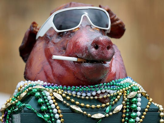 """The remains of the Barbecue Republic's whole hog entry, which they affectionately dubbed """"Billy"""" greets visitors to their booth on the final day of the annual Memphis in May World Championship Barbecue Cooking Contest at Tom Lee Park."""