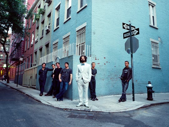 Counting Crows lead singer Adam Duritz, center, has