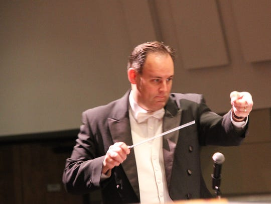 Teun Fetz leads the San Juan College Orchestra during