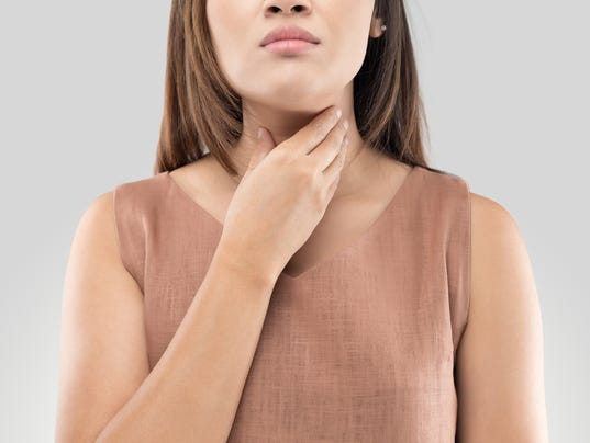 Sore throat woman on gray background