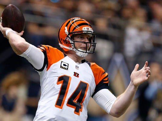 Cincinnati Bengals quarterback Andy Dalton (14) passes in the first half of an NFL football game against the New Orleans Saints in New Orleans, Sunday, Nov. 16, 2014. The Saints won 27-10. (AP Photo/Rogelio Solis)