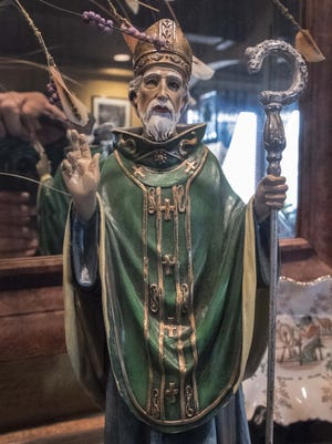 St. Patrick has a prominent place at McNamara's Irish pub  on Monday March 9, 2015, in Donelson.