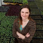 Sally Worley has been named executive director of Practical Farmers of Iowa. She  stands inside a greenhouse at an organic farm in Granger in this file photo.  (Christopher Gannon/The Register)  --  DES.m04XXoneAprofile - shot by Christopher Gannon/The Register on 4/3/13 in Granger, IA