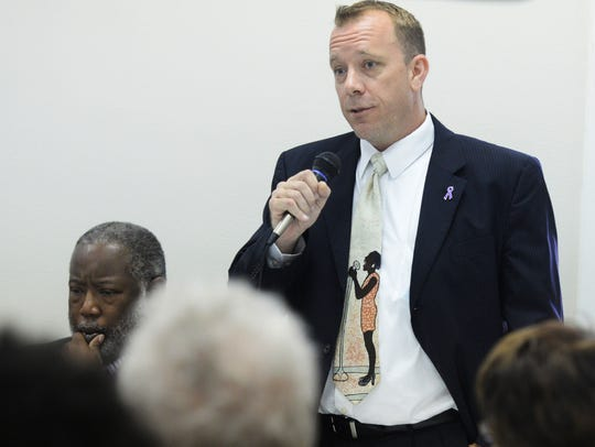 DA Candidate Mark Rogers speaks during the Domestic