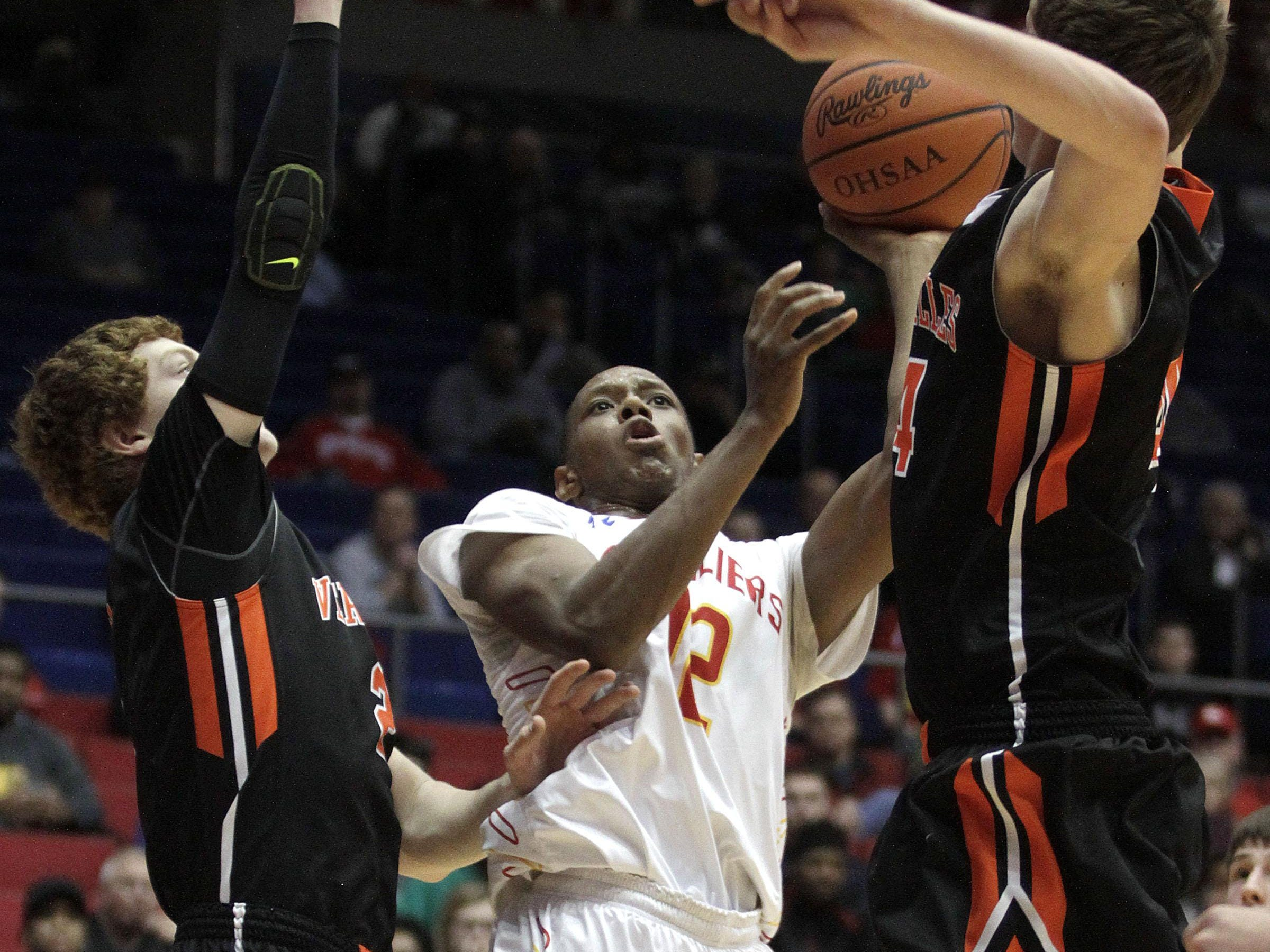 Jordan Gaines of Purcell Marian throws up a shot against Versailles in the Division III district title game at the University of Dayton.