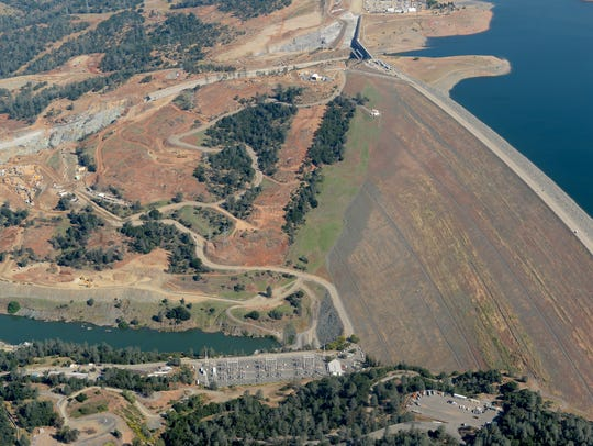 The Lake Oroville Dam and damaged controlled spillway