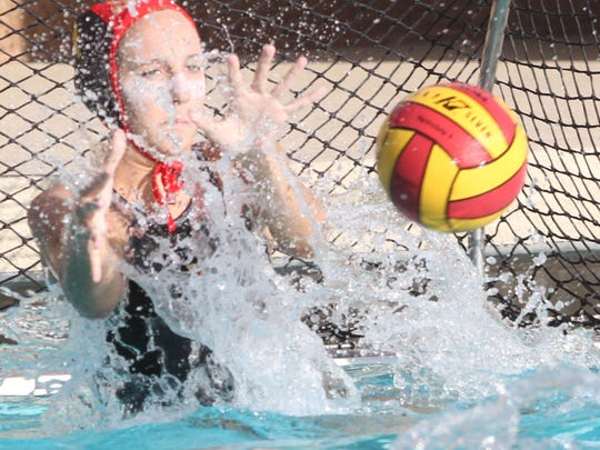 Savannah Clyde, goalie for Palm Desert High School makes one of many saves during her game against Pacifica High School during their CIF game held at Indio High School. Palm Desert won 12-4.