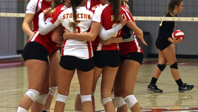 The Palm Desert Aztecs celebrate a point during a home match with the Xavier Prep Saints on Tuesday.