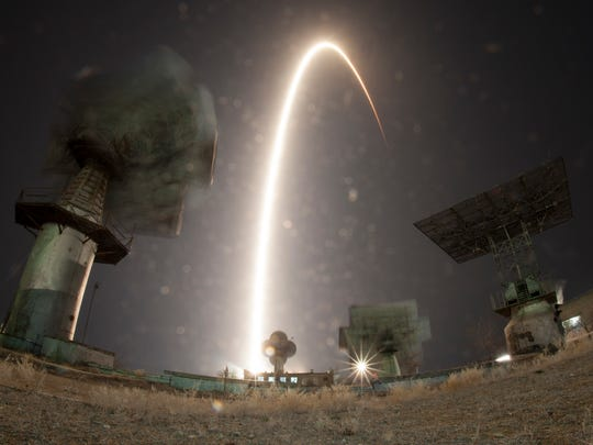 A long exposure shows the Soyuz-FG rocket booster with Soyuz MS-08 space ship carrying a new crew to the International Space Station. The crew blasted off at the Russian leased Baikonur cosmodrome, Kazakhstan, Wednesday, March 21, 2018. The Russian rocket carries Russian cosmonaut Oleg Artemyev, and U.S. astronauts Richard Arnold and Andrew Feustel.