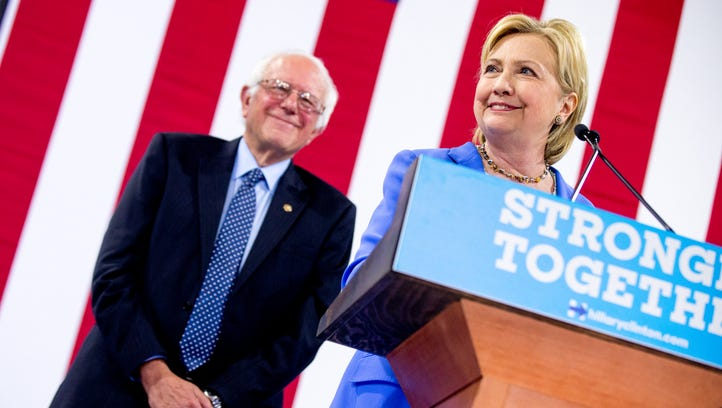 Hillary Clinton and Bernie Sanders appear at a rally
