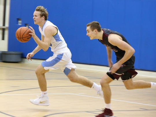 Kyler Howard races down the court.