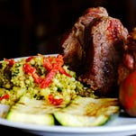 The lamb chops with salsa verde and couscous at The Grape Leaf on Frankfort Ave. July 23, 2015