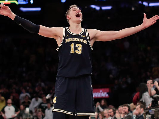 Michigan forward Moritz Wagner (13) reacts as time winds off the clock at the end of an NCAA Big Ten Conference tournament semifinal college basketball game against Michigan State, Saturday, March 3, 2018, in New York. Michigan won 75-64. (AP Photo/Julie Jacobson)