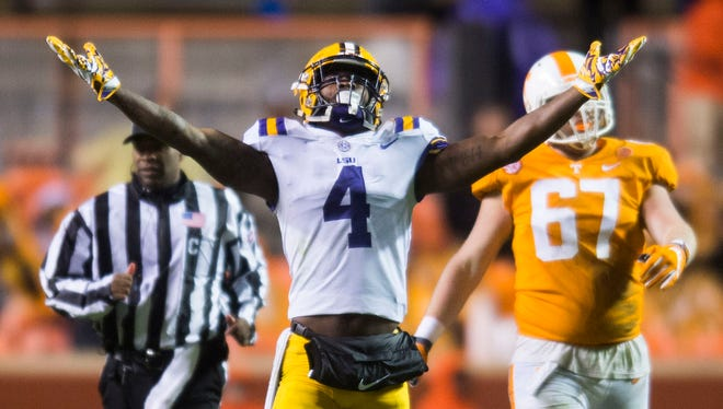 LSU line backer K'Lavon Chaisson (4) celebrates at the end of a game between Tennessee and LSU at Neyland Stadium in Knoxville, Tenn., on Saturday, Nov. 18, 2017. LSU defeated UT 30-10.