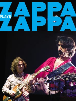 Dweezil Zappa, front, performs the music of his late father Frank Zappa, pictured in the background, as apart of Zappa Plays Zappa band, which will perform at The Englert Theatre on Sept. 26.
