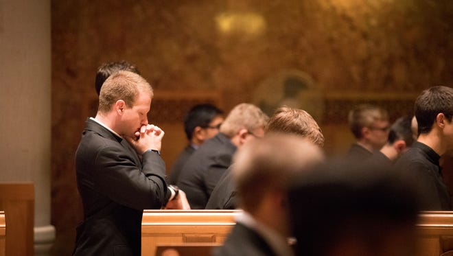 Wed., Nov. 15, 2017: James Porter, a seminarian at Mount St. Mary's Seminary at The Athenaeum of Ohio, prays before evening mass.