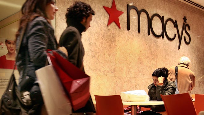 Customers leave a Macy's store in Chicago, Illinois.