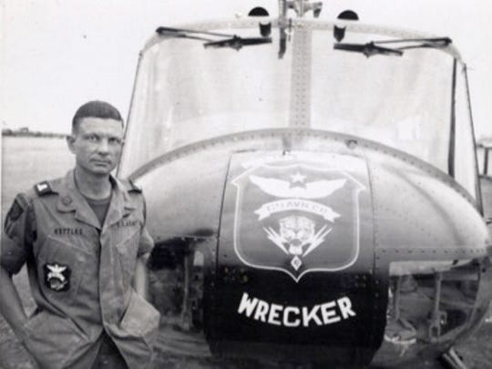 Charles Kettles poses in front of a 121st Aviation Company UH-1H during his second Vietnam tour of duty in 1969.