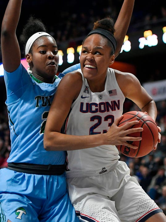 FILE - In this March 4, 2018, file photo, Connecticut's Azura Stevens, right, looks to shoot as Tulane's Harlyn Wyatt, left, defends during the first half of an NCAA college basketball game in the American Athletic Conference tournament quarterfinals at Mohegan Sun Arena, in Uncasville, Conn. UConn forward Azura Stevens is giving up her last year of eligibility and entering the WNBA draft. The 6-foot-6 junior transfer from Duke says she will miss UConn, but it has been a lifelong dream to play in the WNBA. (AP Photo/Jessica Hill, File)