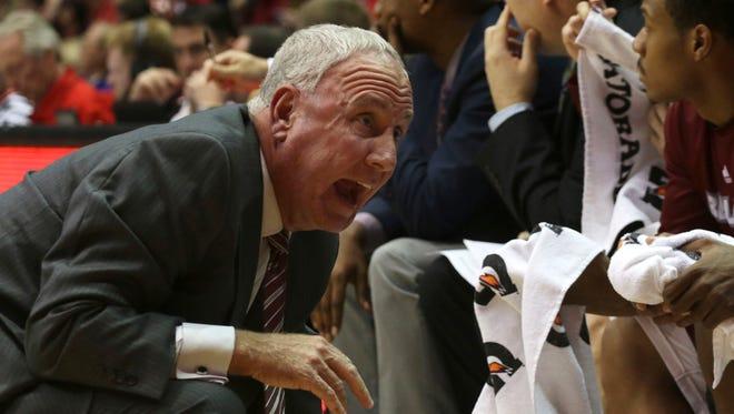 Bellarmine's coach Scott Davenport talks with his players in the first half of an NCAA college basketball exhibition game against Cincinnati in Cincinnati, Monday, Nov. 3, 2014. (AP Photo/Tom Uhlman)