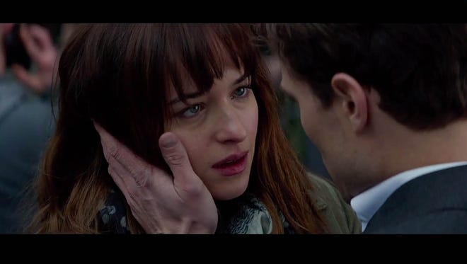 Christian Grey (Jamie Dornan) seduces Anastasia Steele (Dakota Johnson) in a scene from the trailer for 'Fifty Shades of Grey.'