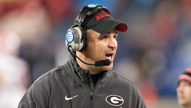 Georgia Bulldogs defensive coordinator Jeremy Pruitt yells out from the sidelines during the second quarter against the Louisville Cardinals in the Belk Bowl held at Bank of America Stadium on Dec 30, 2014.