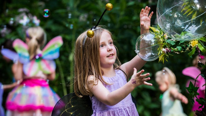 Families braved short rain showers for Faeries, Sprites and Lights at Minnetrista in 2018.