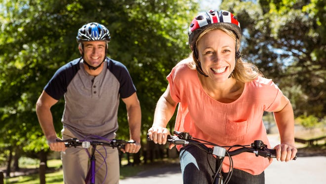 Happy couple on a bike ride on a sunny day.