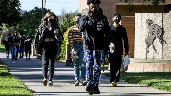 Students walk to their next class Monday morning at the Garden City Community College during the first day of the in-person classes option for the fall semester. GCCC is requiring face masks on the college campus.
