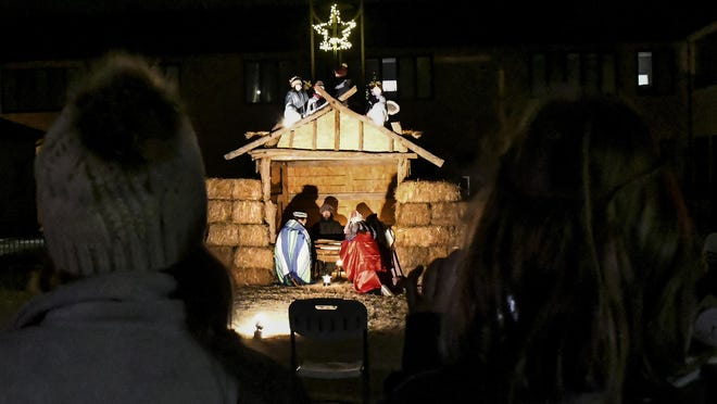 """Members of the First United Methodist Church perform their annual """"Living Christmas"""" Saturday night on the south side of the church. Performances were also held on Sunday evening featuring members of all ages and live animals from a donkey to goats."""