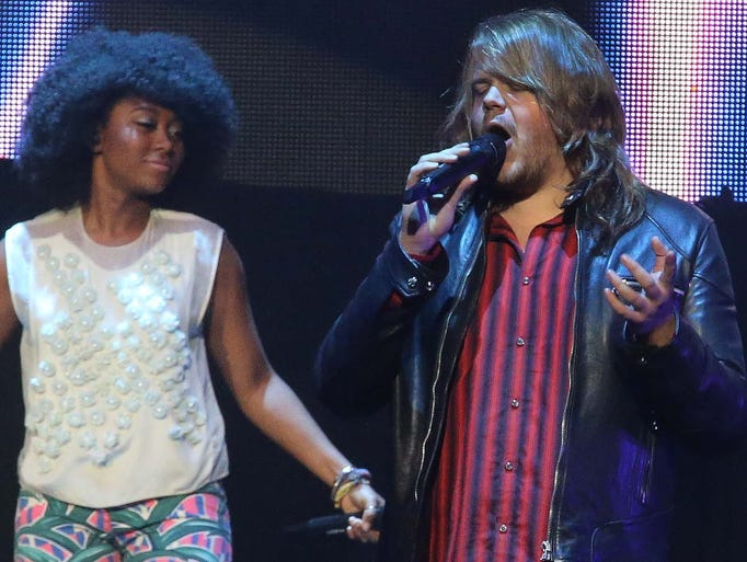 Caleb Johnson sings as Majesty Rose listens. American Idol artists performed at the Indiana State Fair Wednesday August 6, 2014.