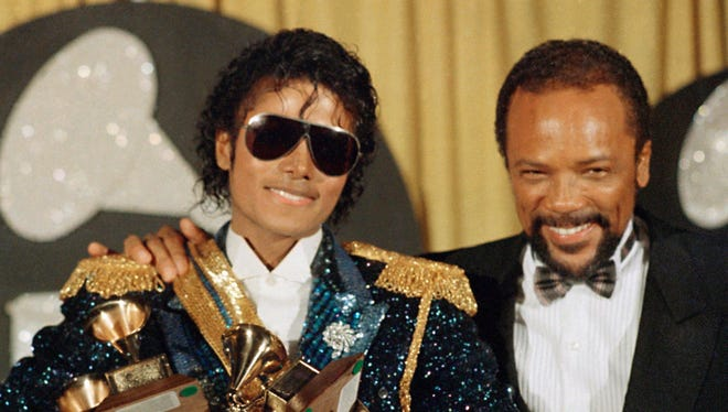 Michael Jackson and Quincy Jones pose for a photograph at the 1984 Grammy Awards ceremony.