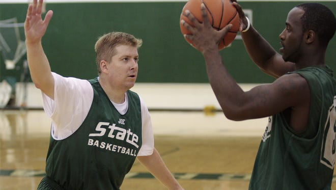LSJ's Joe Rexrode guards MSU's Travis Walton during a media day basketball practice in the auxiliary gym at the Breslin Center on October 8, 2008.  Matthew Mitchell/ Michigan State University Athletic Communications
