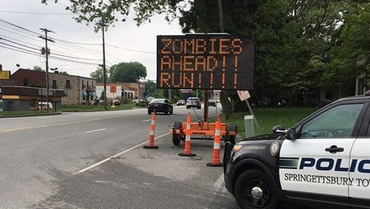 Sign hacked twice in Springetts: zombie warning and vulgarity