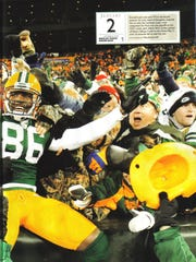 A photo of a 2011 edition of Sports Illustrated that featured Donald Lee's Lambeau Leap, with Donald and Augie (behind hat) Junk congratulating Lee on his 1-yard touchdown.