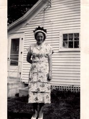 Betty Sufka Kowitz Chirhart stands in front of her