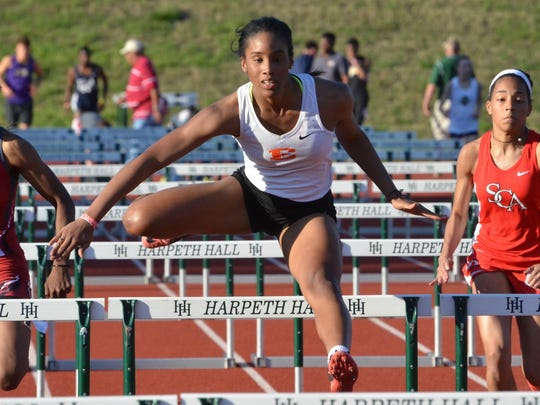 Ensworth junior Tyra Gittens competes in the 100-meter hurdles during the Hill Center Invitational at Harpeth Hall on April 15, 2016.