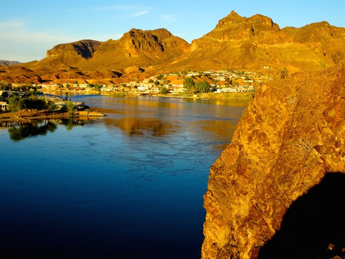 The Colorado River carves canyons, fills lakes and