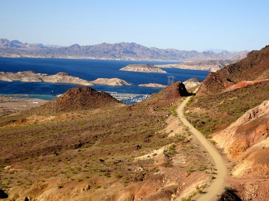 The historic Railroad Trail follows a gentle grade along the shoulder of craggy mountains overlooking Lake Mead.