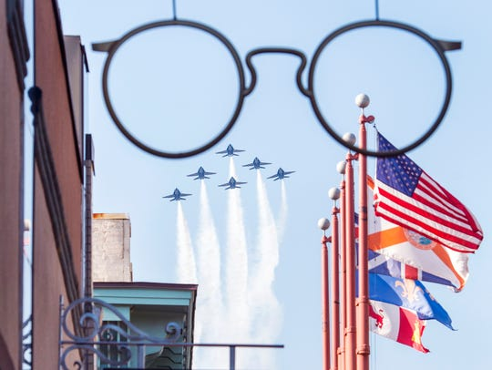 The Blue Angels flyover Palafox Street in downtown
