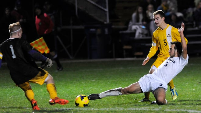 Granville senior Tyler Thomas is challenged by Buckeye Valley keeper Nick Lyons and defender Dalton Spencer on Tuesday. Thomas earned a hat trick and broke the school record for career goals as Granville won its Division II district semifinal 5-0.