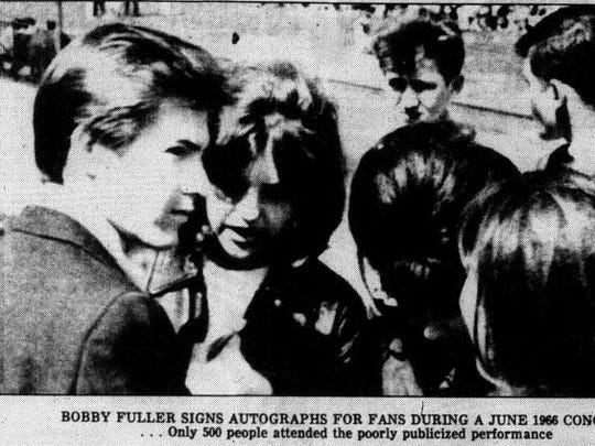 Bobby Fuller signs autographs during a disappointing Massachusetts concert.