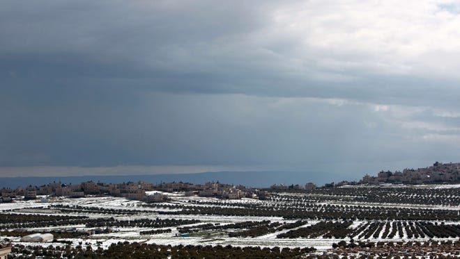 A general view shows the snow-covered olive groves in the West Bank city of Bethlehem.