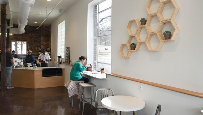 Rachel Moorman enjoys a latte at Honeybee Coffee Company on Tuesday, Jan. 10, 2017, in South Knoxville.