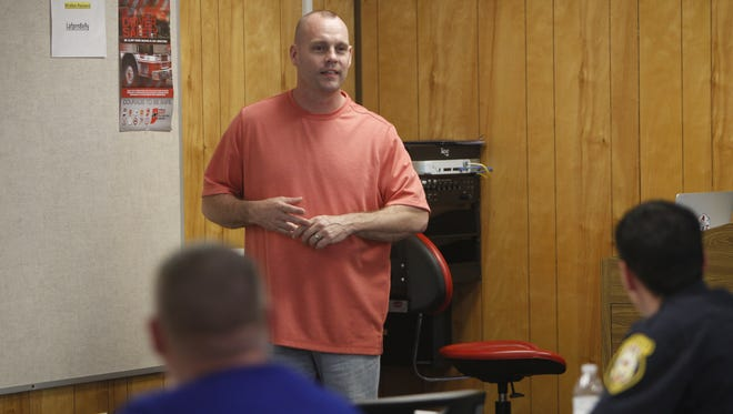 Matt Olson, founder and executive director of Illinois Firefighters Peer Support Team, instructs Lafayette-area firefighter on how to help fellow firefighters who might be struggling with life's events.